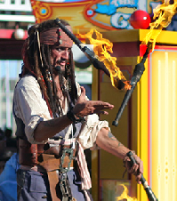 Capt Jack fire juggling on stage at Pier 39